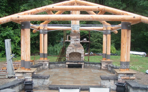 The Bungalow custom log gazebo. Construction photo of the logs and stone