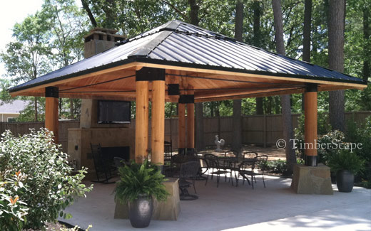 The Bungalow custom log gazebo design is perfect for year-round activity with an undercover fireplace.
